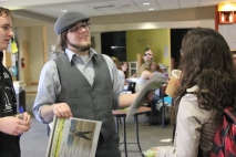 """Newsboy"" Bob talks with students about the latest issue of the paper."