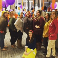 Sara as Snow White and her co-workers as the Seven Dwarfs for Halloween